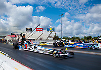 Jul 12, 2020; Clermont, Indiana, USA; NHRA top fuel driver Antron Brown (near) races alongside Clay Millican during the E3 Spark Plugs Nationals at Lucas Oil Raceway. This is the first race back for NHRA since the start of the COVID-19 global pandemic. Mandatory Credit: Mark J. Rebilas-USA TODAY Sports