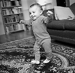 Young child taking first steps at home