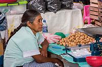 Tlacolula; Oaxaca; Mexico.  Tlacolula Market.  Zapotec Indian Walnut Vendor.