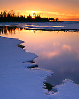 Sunset glow on the frozen shore of Lake Michigan at Peninsula State Park; Door County, WI