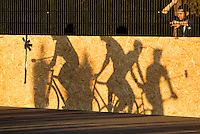 17 AUG 2014 - LONDON, GBR - A spectator watches the London Open Bike Polo tournament final between Mondial and Triple Jay through a fence at Highbury Fields in London, Great Britain (PHOTO COPYRIGHT © 2014 NIGEL FARROW, ALL RIGHTS RESERVED)