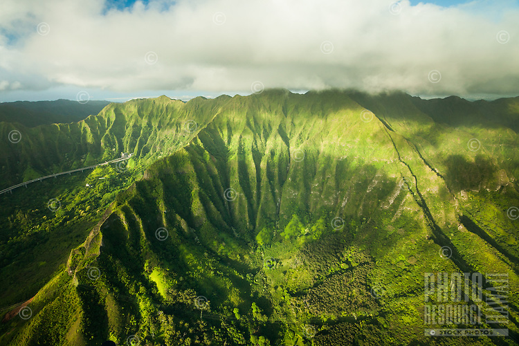 An aerial view of Interstate H-3 and Windward Oahu on a cloudy day.