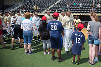 Members of the Wake Forest Demon Deacons baseball team shake hands with members of the Winston-Salem Miracle League prior to the game against the Pittsburgh Panthers at David F. Couch Ballpark on May 20, 2017 in Winston-Salem, North Carolina. The Demon Deacons defeated the Panthers 14-4.  (Brian Westerholt/Four Seam Images)