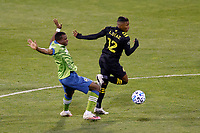 COLUMBUS, OH - DECEMBER 12: Luis Diaz #12 of Columbus Crew battles for the ball against Nouhou #5 of Seattle Sounders FC during a game between Seattle Sounders FC and Columbus Crew at MAPFRE Stadium on December 12, 2020 in Columbus, Ohio.