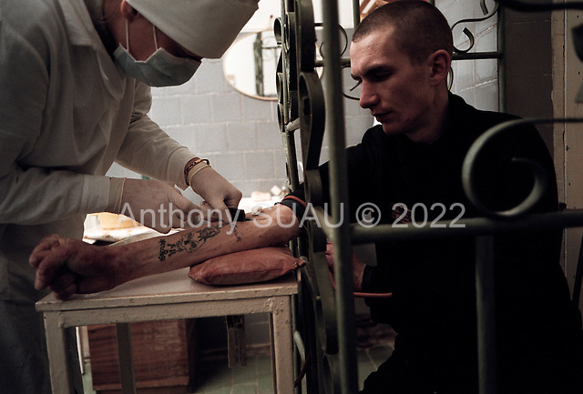 Nizhniy Novogrod, Russia..TB prisoners are given injection treatments through cages.
