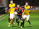 Motherwell v St Johnstone.....01.01.14   SPFL<br /> Gwion Edwards gets away from Keith Lasley<br /> Picture by Graeme Hart.<br /> Copyright Perthshire Picture Agency<br /> Tel: 01738 623350  Mobile: 07990 594431