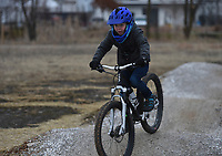 """Theo Howard, 7, rides, Monday, January 11, 2021 along the Mama Bear trail in Bentonville. """"This one is honestly really fun for the kids, and one of the only ones you can ride when it's really muddy and cold out there,"""" said the boy's mom, Emily Howard of Bentonville. Check out nwaonline.com/210112Daily/ for today's photo gallery. <br /> (NWA Democrat-Gazette/Charlie Kaijo)"""