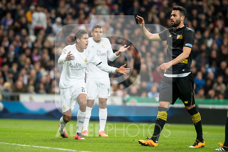 Real Madrid's Raphael Varane and Carlos Henrique Casemiro protesting the referee after a penalty whistle during La Liga match. March 20,2016. (ALTERPHOTOS/Borja B.Hojas)