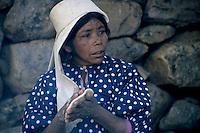 Portrait of a Tarahumaran woman cooking tortillas, Batopilas, Chihuahua, Mexico.