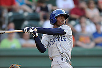 Left fielder Raimel Tapia (15) of the Asheville Tourists bats in a game against the Greenville Drive on Tuesday, July 1, 2014, at Fluor Field at the West End in Greenville, South Carolina. Tapia is the No. 10 prospect of the Colorado Rockies, according to Baseball America. Asheville won, 5-2. (Tom Priddy/Four Seam Images)