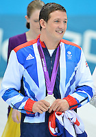 August 01, 2012..Michael Jamieson of Great Britain holding on to his 200m Breaststroke Silver Medal as he walks out of the Aquatics Center at the conclusion of award ceremony on day five of 2012 Olympic Games in London, United Kingdom.
