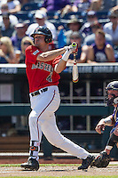Texas Tech Red Raiders designated hitter Cory Raley (4) follows through on his swing against the TCU Horned Frogs in Game 3 of the NCAA College World Series on June 19, 2016 at TD Ameritrade Park in Omaha, Nebraska. TCU defeated Texas Tech 5-3. (Andrew Woolley/Four Seam Images)