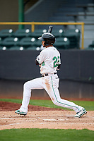 Clinton LumberKings center fielder Luis Liberato (22) follows through on a swing during a game against the Lansing Lugnuts on May 9, 2017 at Ashford University Field in Clinton, Iowa.  Lansing defeated Clinton 11-6.  (Mike Janes/Four Seam Images)