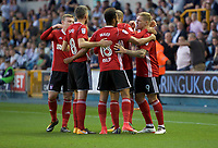Martyn Waghorn of Ipswich Town (right) celebrates with his team mates after scoring to make it 1-2 during the Sky Bet Championship match between Millwall and Ipswich Town at The Den, London, England on 15 August 2017. Photo by Alan  Stanford / PRiME Media Images.