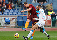Roma's Edin Dzeko, left, kicks the ball as he is challenged by Napoli's Raul Albiol during the Italian Serie A football match between Roma and Napoli at Rome's Olympic stadium, 4 March 2017. <br /> UPDATE IMAGES PRESS/Riccardo De Luca