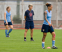 USWNT head coach Pia Sundhage is flanked by forwards Amy Rodriguez and Natasha Kai during practice at Beijing Normal University in preparation for the Olympic gold medal game at Workers' Stadium in Beijing, China.