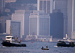 Hong Kong Island harbour waterfront 1990s. skyscrapers modern offices. Star Ferry runs between Kowloon and the Island. China 1991