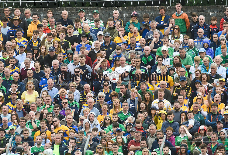 Tense Limerick and Clare fans in the terrace during their Munster championship game in Ennis. Photograph by John Kelly.