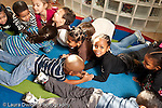 Education preschool 3-4 year olds movement music time group of active children on floor imitating animals horizontal