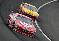Feb 22, 2009; Fontana, CA, USA; NASCAR Sprint Cup Series driver Juan Pablo Montoya (42) leads Kevin Harvick during the Auto Club 500 at Auto Club Speedway. Mandatory Credit: Mark J. Rebilas-
