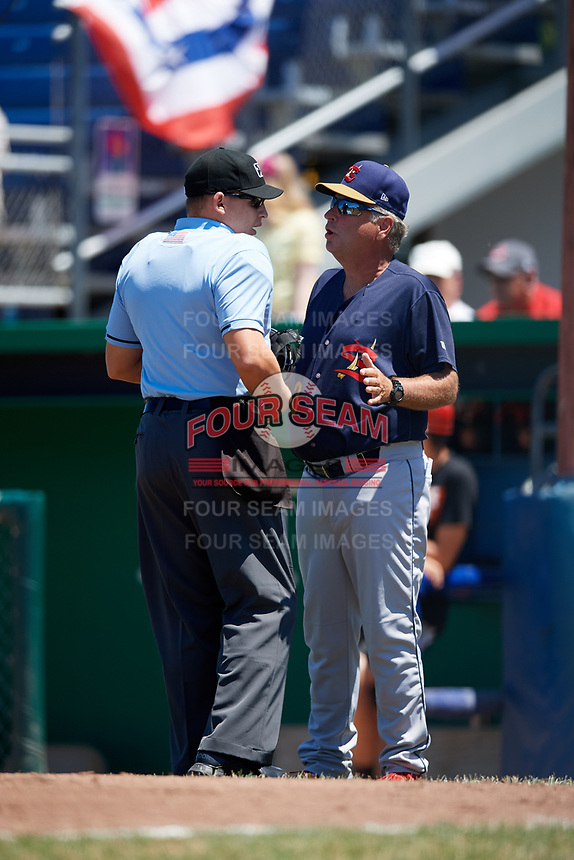 State College Spikes manager Joe Kruzel (13) argues a call with umpire Jordan Sandberg during a game against the Batavia Muckdogs on July 8, 2018 at Dwyer Stadium in Batavia, New York.  Batavia defeated State College 8-3.  (Mike Janes/Four Seam Images)