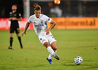 LAKE BUENA VISTA, FL - JULY 18: Rolf Feltscher #25 of LA Galaxy passes the ball during a game between Los Angeles Galaxy and Los Angeles FC at ESPN Wide World of Sports on July 18, 2020 in Lake Buena Vista, Florida.