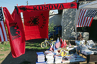 Yugoslavia. Kosovo. Pristina. Daily life. Small shop on the road selling flags from Kosovo ( or Kosova), USA (american), and school materials (like books, notes books, pen,pencils,..) for pupils and students. The national flag of Albania is a red flag, with a silhouetted black double-headed eagle in the centre. It is the only red and black flag of a recognised sovereign state. © 2001 Didier Ruef