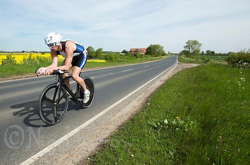 26 MAY 2013 - BRIGG, GBR - Phil Binch (Masters 40) of Lincsquad on the bike during the 2013 Brigg Bomber Quadrathlon, a World Quadrathlon Federation World Cup round and the British Championships, held in Brigg, Lincolnshire, Great Britain .(PHOTO (C) 2013 NIGEL FARROW)