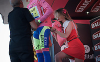 maglia rosa Alberto Contador (ESP/Tinkoff-Saxo) getting some help on the podium<br /> <br /> stage 17: Tirano - Lugano (SUI) (134km)<br /> 2015 Giro d'Italia