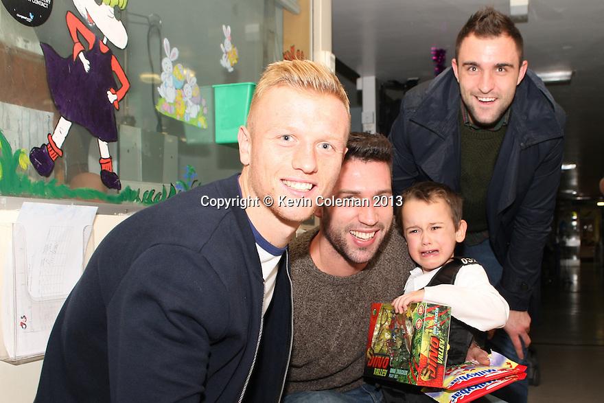 Jordan Burrow, Steve Arnold and Peter Hartley<br /> Stevenage FC players visit Lister Hospital Children's ward.  <br />  - Lister Hospital, Stevenage - 18th December, 2013<br />  © Kevin Coleman 2013