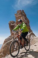 "Mountain biking past the ""India Gate"" on the highest motorable road in the world,  Himalayan Mountains, Ladakh, India."