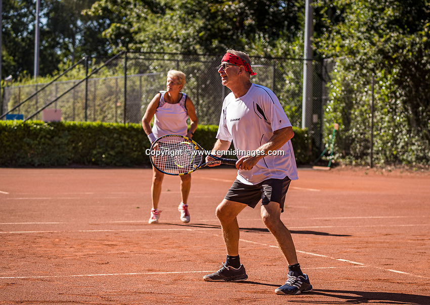 Hilversum, The Netherlands,  August 21, 2020,  Tulip Tennis Center, NKS, National Senior Tennis Championships, Mixed doubles 60+,  Sylvia Lievers-Kronenburg (NED) Patrick Marteijn (NED)<br /> Photo: Tennisimages/Henk Koster