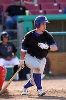 Beau Taylor #13 of the Stockton Ports bats against the High Desert Mavericks at Stater Bros. Stadium on May 27, 2012 in Adelanto,California. High Desert defeated Stockton 6-5.(Larry Goren/Four Seam Images)
