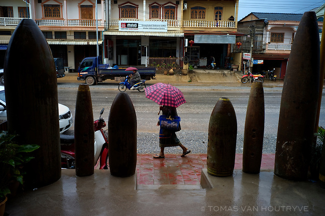A row of unexploded bombs dropped by the U.S. military during the Secret War in the 1960's and 70's serves as decoration for a restaurant in Phonsavan, Xieng Khoung province, Laos on March 15, 2011.