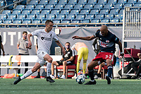 FOXBOROUGH, MA - JULY 25: USL League One (United Soccer League) match. Ethan Vanacore-Decker #7 of Union Omaha bests Tiago Mendonca #33 of New England Revolution II during a game between Union Omaha and New England Revolution II at Gillette Stadium on July 25, 2020 in Foxborough, Massachusetts.