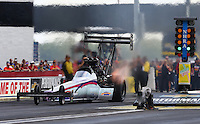 Aug. 31, 2013; Clermont, IN, USA: NHRA top fuel dragster driver Leah Pruett during qualifying for the US Nationals at Lucas Oil Raceway. Mandatory Credit: Mark J. Rebilas-