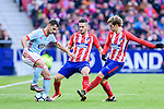 Lucas Ariel Boye of RC Celta de Vigo (L) fights for the ball with Sime Vrsaljko of Atletico de Madrid (C) and Antoine Griezmann of Atletico de Madrid (R) during the La Liga 2017-18 match between Atletico de Madrid and RC Celta de Vigo at Wanda Metropolitano on March 11 2018 in Madrid, Spain. Photo by Diego Souto / Power Sport Images