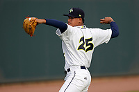 Delvin Capellan (25) of the Columbia Fireflies warms up before a game against the Charleston RiverDogs on Tuesday, May 11, 2021, at Segra Park in Columbia, South Carolina. (Tom Priddy/Four Seam Images)