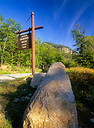 Entering Crawford Notch Sign with Frankenstein Cliff in the background along Route 302 in the White Mountains of New Hampshire USA.