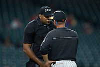 Home plate umpire Joe Harris listens to Sam Houston State Bearkats assistant coach Jay Sirianni during the game against the Mississippi State Bulldogs during game eight of the 2018 Shriners Hospitals for Children College Classic at Minute Maid Park on March 3, 2018 in Houston, Texas. The Bulldogs defeated the Bearkats 4-1.  (Brian Westerholt/Four Seam Images)