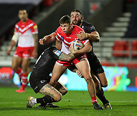 20th November 2020; Totally Wicked Stadium, Saint Helens, Merseyside, England; BetFred Super League Playoff Rugby, Saint Helens Saints v Catalan Dragons; Jack Welsby of St Helens is tackled by Alrix da Costa of Catalan Dragons