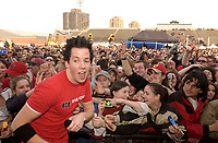 , 2002 File Photo<br /> <br /> Rock group Simple Plan  singer reach out to his fans during an outdoor concert<br /> <br /> <br /> (Mandatory Credit: Photo by Sevy - Images Distribution (©) Copyright 2002 by Sevy<br /> <br /> NOTE :  D-1 H original JPEG, saved as Adobe 1998 RGB