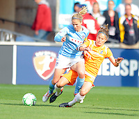 # 5 Lindsay Tarpley of the Chicago Red Star s #38 Julianne Sitch of Sky Blue FC battle for a midfield ball.  Sky Blue FC beat the Red Star 2-0.
