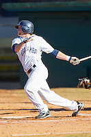 Ryan Bostian #20 of the Catawba Indians follows through on his swing against the Shippensburg Red Raiders at Newman Park on February 12, 2011 in Salisbury, North Carolina.  Photo by Brian Westerholt / Four Seam Images