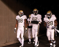 Pittsburgh wide receivers Oderick Turner (88), Jonathan Baldwin (82) and running back Dion Lewis (28) take the field for the second half. The West Virginia Mountaineers defeated the Pittsburgh  Panthers 19-16 on November27, 2009 at Mountaineer Field at Milan Puskar Stadium, Morgantown, West Virginia.