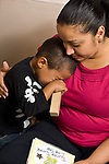 preschool 2-4 year olds separation beginning of school year female teacher comforting crying boy