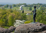 Gettysburg National Military Park, PA<br /> Statue of Brig. Gen. Warren on Little Round Top overlooking the Pennsylvania Memorial and Gettysburg battlefield