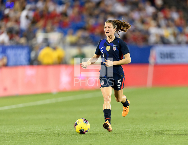 FRISCO, TX - MARCH 11: Kelley O'Hara #5 of the United States brings the ball up the field against Japan during a game between Japan and USWNT at Toyota Stadium on March 11, 2020 in Frisco, Texas.