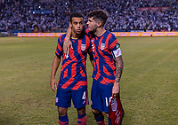 SAN PEDRO SULA, HONDURAS - SEPTEMBER 8: Tyler Adams #4 and Christian Pulisic #4 of the United States talk before the huddle during a game between Honduras and USMNT at Estadio Olímpico Metropolitano on September 8, 2021 in San Pedro Sula, Honduras.