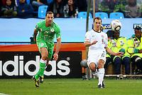 Steve Cherundolo (6) of USA and Medhi Lacen (L) of Algeria. USA defeated Algeria 1-0 in stoppage time in the 2010 FIFA World Cup at Loftus Versfeld Stadium in Pretoria, Sourth Africa, on June 23th, 2010.